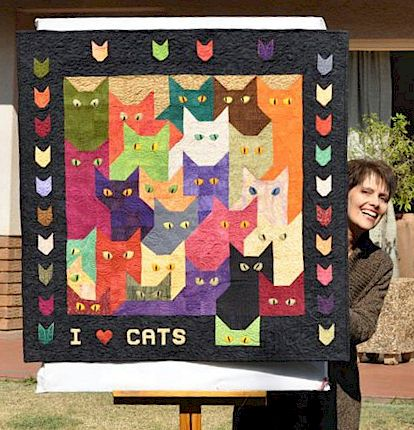 thelda with her Lots of Cats Quilt