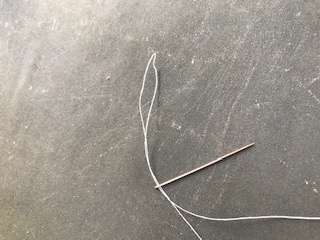 How to make a widow's knot -Pull the thread to make a bigger loop